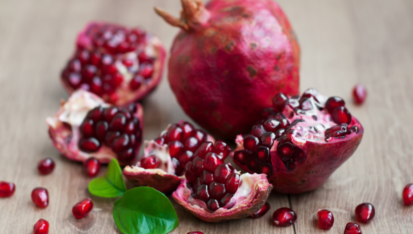 Quartered pomegranate and seeds
