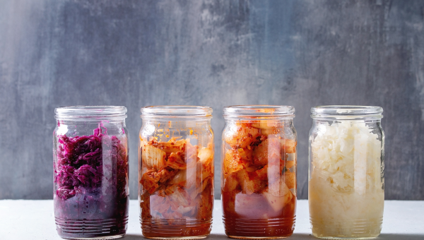 A rainbow of fermented vegetables in glass jars